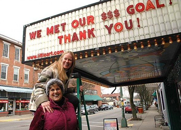 The local community helped the Little Art Theatre to reach its fundraising goal of $475,000 to complete a total renovation of the facility. Little Art Director Jenny Cowperthwaite and capital campaign co-chair Dorothy Scott spelled out the good news on the marquee this week. (Photo by Lauren Heaton)