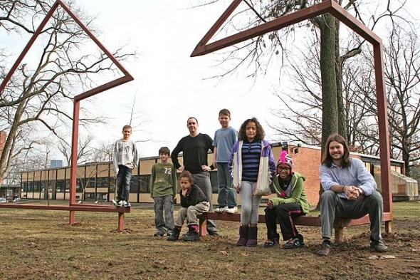 Mills Lawn students from left, Roman Newsome, Ben Mooneyham, Eridon Stewart, Principal Matt Housh, Noah Van Hoose, Sydney Collins, Annlyn Foster and teacher Jeff May, posed with the sculpture last week on the south school lawn.