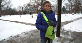 Mills Lawn sixth grade student Teymour Fultz helped youth cross safely to school this week, as parents, teachers and the wider community continue to discuss the security needs for the local school district. (Photo by Lauren Heaton)