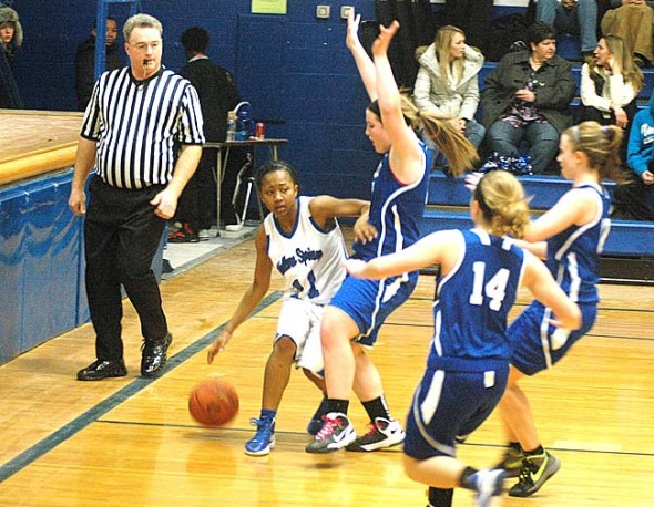 For the first time in the school's history, the Yellow Springs High School girls basketball team this week won a share in the Metro Buckeye Conference title. Brianna Ayres is shown here driving in for a show during the team's Feb. 1 win against Xenia Christian, 55–45. (Photo by Megan Bachman)
