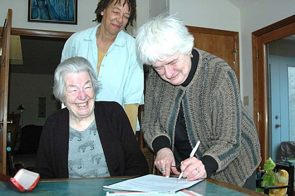 After deciding recently to donate her body to science when she dies, Jane Baker, left, last week signed an anatomical gift donation to the Boonshoft School of Medicine at Wright State University. The decision was just one of many that a group of local residents, including Jane Brown, right, and Ona Harshaw, have begun talking about as they consider end-of-life issues for themselves and their families. (Photo by Lauren Heaton)