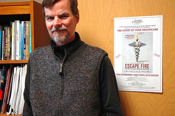 Antioch University Midwest is sponsoring a free documentary, 'Escape Fire: The Fight to Rescue American Healthcare,' at the school on Wednesday, Feb. 27 at 6 p.m., with refreshments at 5:30 p.m. Shown above is Kent De Spain, the new chair of the school's program for healthcare consumer advocacy/patient navigation. (Photo by Diane Chiddister)