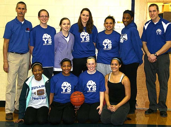 Over the weekend the YSHS girls basketball team won the Division IV sectional tournament title for the first time since 1987. They defeated Cincinnati Seven Hills 44–24 at Monroe High School. The team includes, from left, back row: Coach Tim Barga, Molly Hendrickson, Anna Mullin, Paloma Wiggins, Rachele Orme, Angela Allen, Assistant Coach Jack Hatert; front row: Brianna Ayers, Kennedy Harshaw, Keturah Fulton and Maryah Martin. (Submitted photo by Vince Peters)
