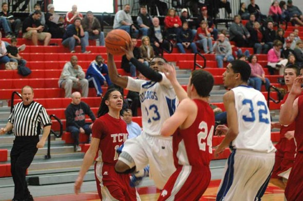PJ Russell takes one of his game-high shots in the first period against Tri-County.