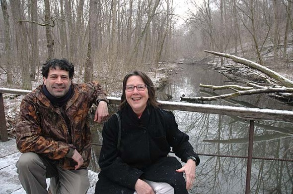 Kneeling above the now permanently preserved Yellow Springs Creek, Glen Helen Ecology Institute Director Nick Boutis and Tecumseh Land Trust Director Krista Magaw celebrated the purchase last week of a conservation easement that protects the Glen from future development or subdivision. (Photo by Lauren Heaton)