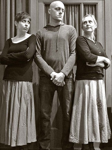 The revived Center Stage community theater group will present Arthur Miller's The Crucible this weekend and next on Fridays and Saturdays, March 8, 9, 15 and 16 at the First Presbyterian Church. Shown above are from left, Kayla Graham, Brendan Sheehan and Ellen Ballerene playing Abigail, John Proctor and Elizabeth Proctor. (Submitted photo)