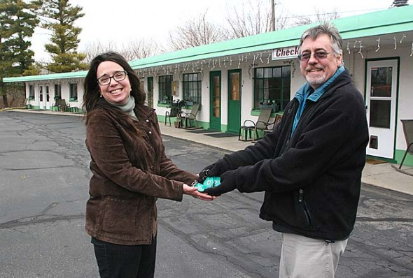 On March 1, Eric Clark handed over all the keys to the Springs Motel he owned for 10 years to Kat Krehbiel, who owns New Liberty Farms on Meredith Road. (Photo by Lauren Heaton)