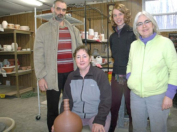 Hungarian master potters Vera and Ferenc Bognar are visiting Yellow Springs this week as guests of John Bryan Community Pottery, where they will present evening studio viewings on Wednesday, Thursday and Friday from 5 to 8 p.m. and an all-day workshop on Saturday. Shown above are, from left, the Bognars, with Vera at the wheel in front; JBCP manager Allison Paul and Beth Holyoke. (photo by Diane Chiddister)
