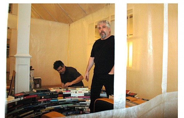 "Curator Michael Cassellli and artist Kurt Miyazaki in one of the ""rooms"" of the American home inside a transformed Herndon Gallery."