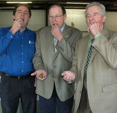 Enviroflight's Glen Courtright, ODA Director David Daniels and state veterinarian Tony Forshey had a mid-morning bug snack.