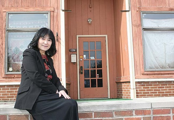 Jenny Chen sat outside the Dayton Street building that until March 31 housed Chen's Asian Bistro.  Photo by Suzanne Szempruch