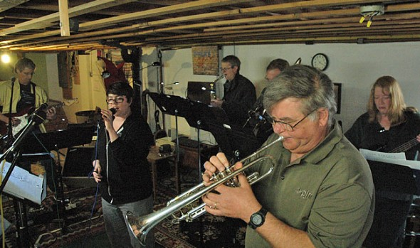 Ohio Brass & Electric, a new local band, rehearsed in Mek Logan's basement this week. From left in front are Skip Leeds, Bob Fannin and Emily Seibel. (Photo by Megan Bachman)