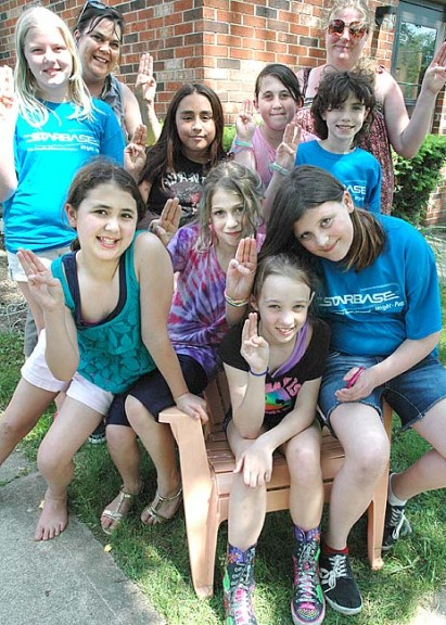 Yellow Springs Girl Scout Troop 30349 is sponsoring the documentary Finding Kind, on female bullying, on Friday, May 24, at 7 p.m. at the Bryan Center gym. Following the film will be a community discussion. Shown here are, from left top row, Peyton Gray, leader Wendy Hoff, Esperanza Pennartz, Isabella Kraus, Madrid Joy and leader Erin Hankie; front row from left, Victoria Osborne, Isaiah Crawford, Sammi Woolley and Julia Hoff. (Photo by Diane Chiddister)