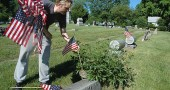 About 20 local men and women from the Yellow Springs Odd Fellows lodge placed American flags on the graves of veterans and Odd Fellows at the Glen Forest Cemetery last Friday afternoon. (Photo by Diane Chiddister)