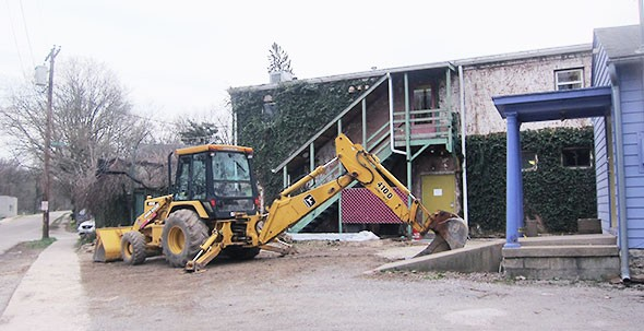 excavator prepares new patio area