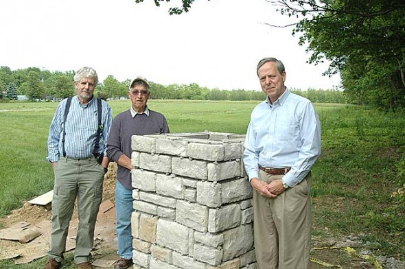 When the Glen Forest Cemetery Association dissolved earlier this year it transferred ownership of the village cemetery to the Miami Township Trustees. Pictured are former Association members, from left, Rod Hoover and Don Fulton with Trustee Chris Mucher in front of the expanded cemetery lot across U.S. 68 from the original one. (Photo by Lauren Heaton)