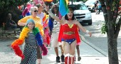 Isaiah Crawford, front left, led Saturday's Pride Parade through the village with Melissa Heston in Wonder Woman reprise flying her colors. Joan Chappelle, Ona Harshaw, and John Booth followed, trailed by a multi-block line of about 200 participants. (Photo by Lauren Heaton)