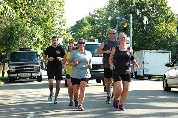 "The ""Flame of Hope"" was carried through Yellow Springs yesterday, one of over 150 communities, to  create awareness of Special Olympics and raise funds for the program. (Photo by Matt Minde)"
