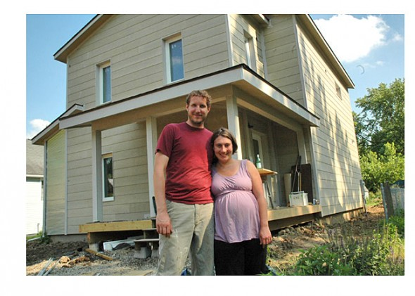 Andrew and Anisa Kline in front of their home on West Davis Street.