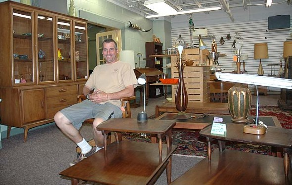 Terry Fox is the owner of the new store Atomic Fox, at the former survival store location in Kings Yard. The store specializes in mid-20th century furniture and housewares. (Photo by Megan Bachman)