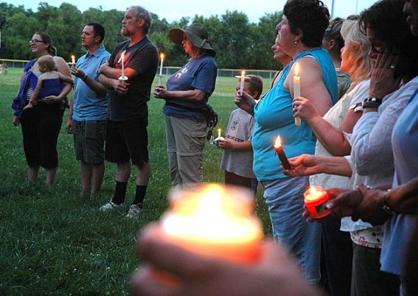White and black neighbors came together for a silent candlelight vigil on Sunday night for Trayvon Martin, the 17-year-old African-American victim of a fatal shooting in Florida. (Photo by Megan Bachman)