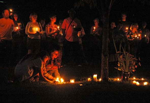 Over 100 villagers gathered at Mills Lawn for candlelight vigil on Wendesday, July 31, the night after the gun fight that ended in the death of villager Paul Schenck. State investigators released some preliminary findings this week, but the full report on how Schenck died won't be submitted to the Greene County prosecutor for another several weeks or even months. (Photo by Lauren Heaton)