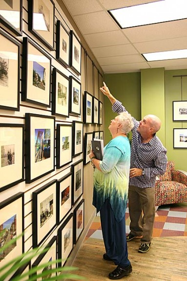 Photographer Andy Snow points out a photo to Antioch University Midwest President Ellen Hall from his exhibit on the 100-year anniversary of the Dayton flood, which is currently on exhibit in the AUM lobby. The exhibit, which opened last Saturday, runs through October. (Photo by Suzanne Szempruch)