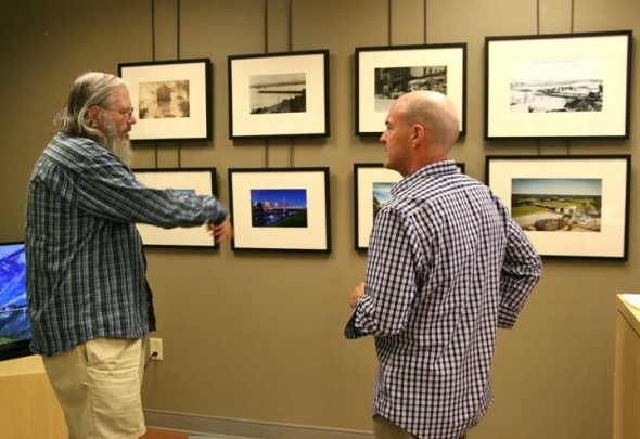 "Yellow Springs local, JK Lourens talked with photographer Andy Snow at the gallery opening of ""Then & Now"" on Saturday."
