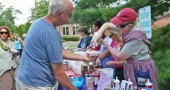 Janeal Ravndal served cool whip to anyone who wanted it at last Sunday's ice cream social at Friends Care Community.