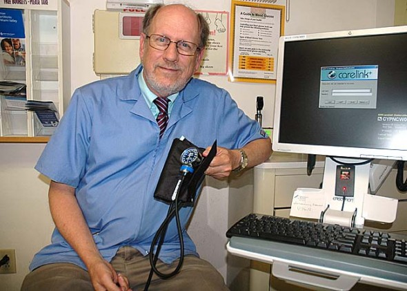 Dr. Paul Van Ausdal will retire after 34 years at Community Physicians on Friday, Sept. 27. The office will honor him with an open house for the community from 2 to 5 p.m. on that day. (Photo by Diane Chiddister)