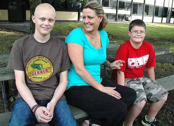 Chase Barclay, left, with his mother, Mills Lawn Elementary School fifth-grade teacher Dionne, and younger brother, Tucker. Chase, a 15-year-old Yellow Springs High School sophomore, was diagnosed with a rare form of lung cancer in April. Over the last six months the community has supported him and his family by fundraising,  printing T-shirts and sending prayers. (Photo by Megan Bachman)