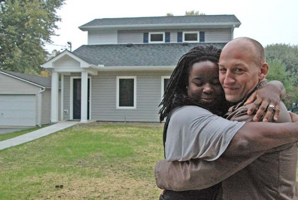 Brett and Isis Henderson will soon close on a house on West Davis Street built by local affordable housing group Home, Inc. The Hendersons hope to raise a family in the three-bedroom house, which was built to use about half the energy of a conventional home. (Photo by Megan Bachman)