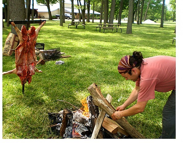 La Pampa Grill chef Mariano Rios prepares to roast a local pig at Peifer Orchards.