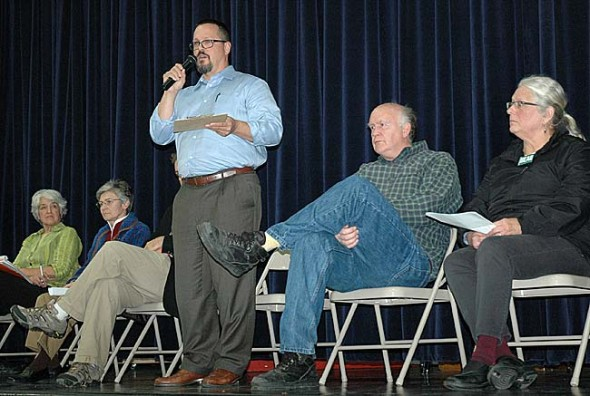 Yellow Springs school board candidate Evan Scott spoke last week during a Candidate's Forum sponsored by the James A. McKee Group, which took place at Mills Lawn gym. Also shown are, from left, Aïda Merhemic, Angela Wright, Steve Conn (behind Scott) and Allen Hunt. (Photo by Lauren Heaton)