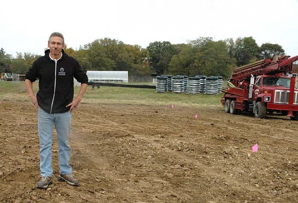 This week Antioch College facilities manager Reggie Stratton stood in a section of the Antioch farm where 150 geothermal wells will be drilled 300 feet underground over the next month. Flags note the locations of the wells. Antioch's new $8.8 million central geothermal system will heat and cool campus buildings while saving $400,000 in annual energy costs. (Photo by Megan Bachman)
