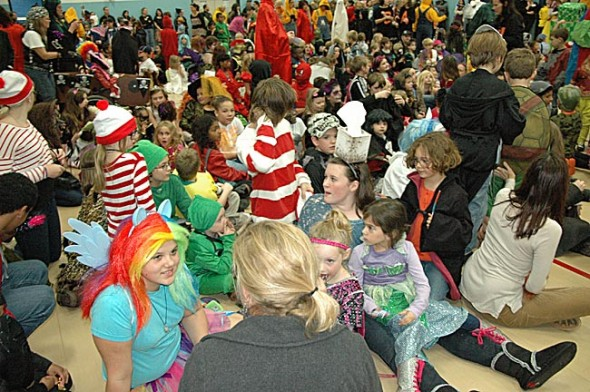 Bursts of color and activity filled the Mills Lawn School gymnasium as kids cavorted in costumes. (Photos by Matt Minde)