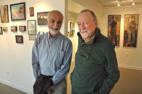 Local painters Parviz Dadras, left, and Thomas Verdon share the gallery at the Yellow Springs Arts Council with exhibits that run through Dec. 1. Both longtime Yellow Springers turned to painting full time later in life and explore human nature through portraits. But Verdon, whose art is visible on the right, uses classical painting techniques, while Dadras incorporates symbolism in his works, which can be seen on the left. An opening reception for the exhibits will be from 6 to 9 p.m. Friday, Nov. 15, with a talk from Verdon starting at 7 p.m. (Photo by Megan Bachman)