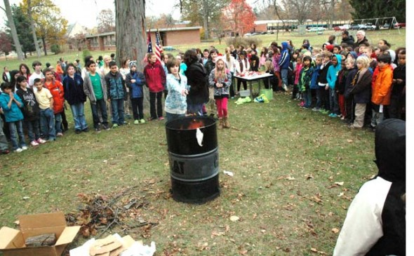 Many Mills Lawn School students, teachers and veterans participated this Veterans Day in a flag retirement ceremony, wherein a flag too damaged to fly as a fitting emblem is burned. (Photos and video by Matt Minde)