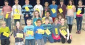 The 2013 Mills Lawn School Spelling Bee participants lined up for a group shot after the event. (Photos by Matt Minde)