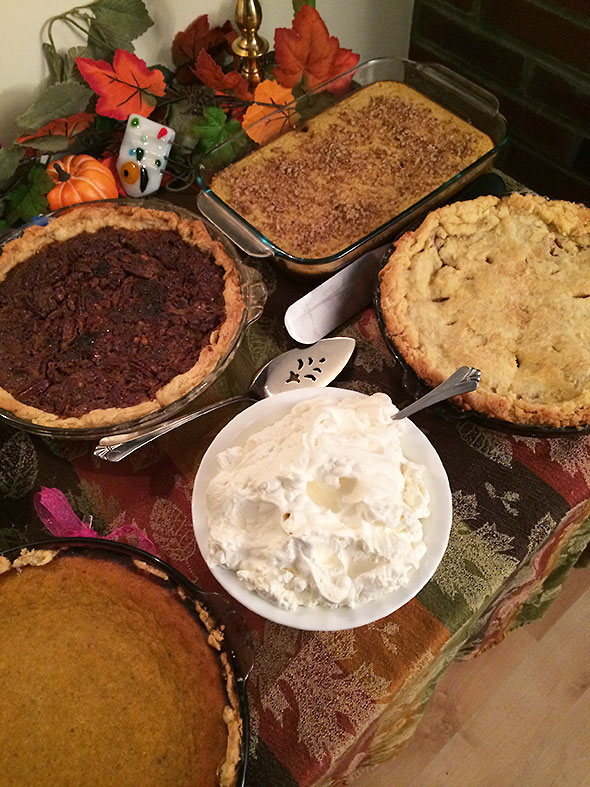 pie table with whipped cream