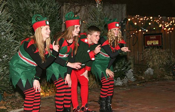 At Friday night's downtown Yellow Friday events, Santa's Elves performed as a crowd of adults and children gathered for the tree lighting in Kings Yard. They will return for an encore performance when Santa comes to visit the Glen Helen building on Saturday, Dec. 14. (Photo by Suzanne Szempruch)