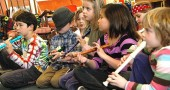 The Antioch School hired Dennis Farmer for a yearlong arts residency, funded partially by the Emily Bailey Fund. Shown above are several Younger Group future musicians trying their hands at recorders, from left, Isaac Stiles (partially obscured), Jackson Grotes, Kian Barker, Ayla Current, Olivia Hasek, Scout Espinosa, Sophia Hale and Caroline Tucker. (Photo by Lauren Heaton)