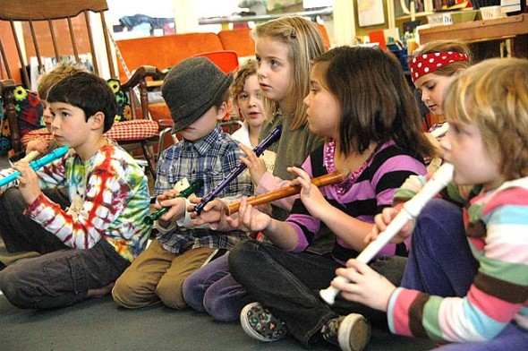 The Antioch School hired Dennis Farmer for a yearlong arts residency, funded partially by the Emily Bailey Fund. Shown above are several Younger Group future musicians trying their hands at recorders, from left, Isaac Stiles (partially obscured), Jackson Grotes, Kian Barker, Ayla Current, Olivia Hasek, Scout Espinosa, Sophia Hale and Caroline Tucker. See more pictures at bottom of story. (Photo by Lauren Heaton)