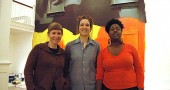 "Antioch College's art faculty members and resident scholars are exhibiting in ""Currencies,"" a new Herndon Gallery show running from Dec. 12–Feb. 14, with an opening reception from 7 to 9:30 p.m, Thursday, Dec. 12. From left are faculty members Sara Black, a sculptor, Raewyn Martyn, a painter, and Gabrielle Civil, a performance artist, in front of Martyn's painting, portions of which will be peeled away to reveal new images during the course of the exhibit. (Photo by Megan Bachman)"