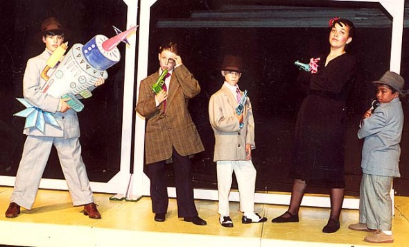 "Yellow Springs Kids Playhouse is celebrating its 20th anniversary in 2014 with special events and performances. From left, Andrew Beal, Sam Jacobs, Alban Holyoke, Sahara Lawson-Lance and Martin Bakari perform in ""Dick Tracy: the Musical"" in 1995. YSKP also hopes to reconnect with 1,200 alumni during the year to complete a survey on how the local youth theater experience influenced them. Alumni should contact YSKP at admin@yskp.org. (Submitted photo)"