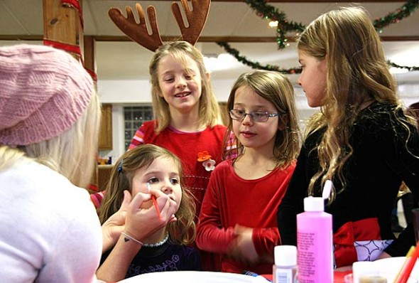 When Santa came to the Yellow Springs United Methodist Church this year, face painting was a big hit, as Olivia Hasek, Lily Kibblewhite and Sophia Hale waited in line and watched as Gabriella Kibblewhite had her turn. (Photos by Suzanne Szempruch)