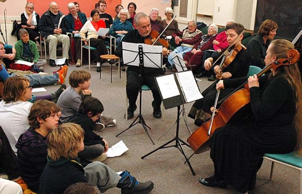 From left, Matthias Enderle, violin, and Wendy Champney-Enderle, viola, of the Zurich, Switzerland-based Carmina Quartet, will perform at the annual Friends Music Camp winter benefit concert at 3 p.m. Sunday, Dec. 29, at the Yellow Springs Senior Center. Here they perform at the 2011 concert. The Enderle family will perform this year with their daugher, Ciara, an up-and-coming cellist. Other Friends Music Camp alumni and instructors to perform at the concert include Martha Hyde, Martin Bakari, Minnita Daniel-Cox and local teen New Orleans-style brass band, Sassabrass. (Photo by Matt Minde)