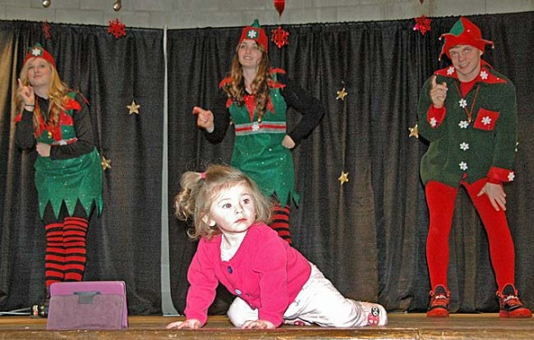 Audrey Creighton became the self-appointed star of the Holiday Fest in the Springs show on Saturday when she climbed up on stage as the elves gave their seasonal admonition about pouting and crying. The afternoon's performance at the Vernet Ecological Center featured a chorus of the Mills Lawn fifth and sixth graders and dance and vocal concerts by each of YS Kids Playhouse classes in hip-hop, ballet and singing. (Photos by Lauren Heaton)