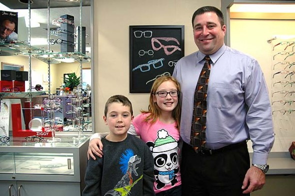 Optometrist Todd McManus, pictured above with his children, Gavin, 7, and Haley, 10, recently opened a new office at the south end of Yellow Springs. He also practices in Xenia with a satellite office in Enon. (Photo by Carol Simmons)