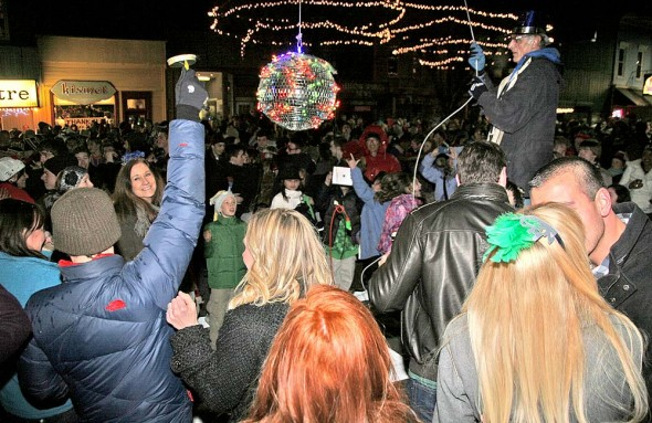 A huge crowd of people packed Short Street and Xenia Ave. to bring in the New Year. Though the countdown was not exactly audible, the enthusiasm ramped up at midnight. (Photo by Suzanne Szempruch)